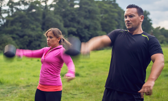 Tom and MAz exercising with kettlebells